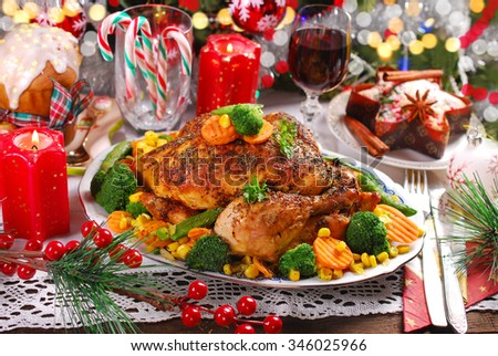 roasted whole chicken with  broccoli,carrot,corn and green peas on christmas table - stock photo
