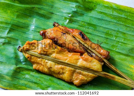 Roasting chicken on a banana leaf