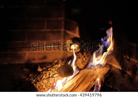 Roasting marshmallows over a fire for smores indoors