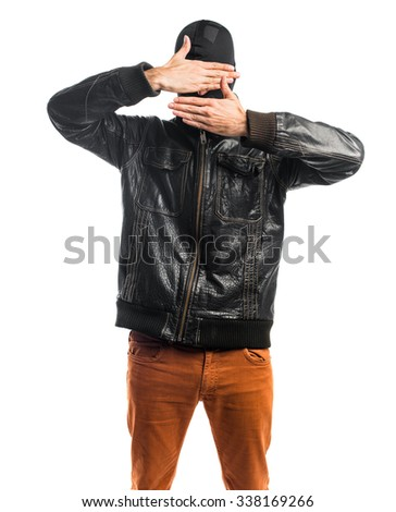 Robber covering his face - stock photo