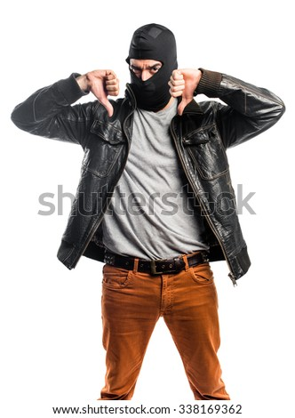 Robber doing bad signal - stock photo