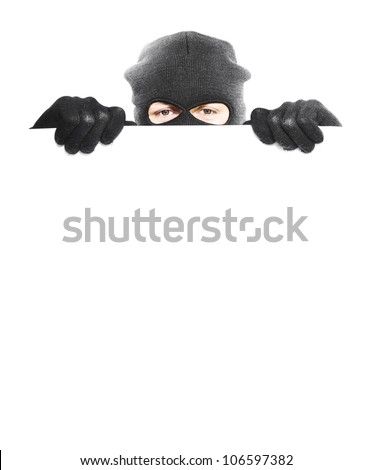 Robber hiding behind a empty white sign with space for text, isolated on white background