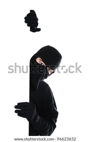 Robber hiding under a wall on white background - stock photo