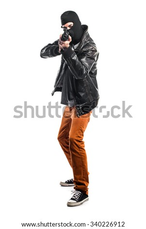 Robber holding a rifle - stock photo