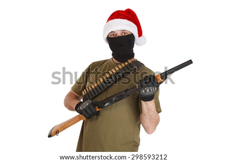 robber in a cap of Santa Claus with shotgun  isolated