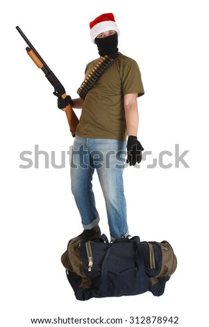 robber in a cap of Santa Claus with shotgun  isolated - stock photo