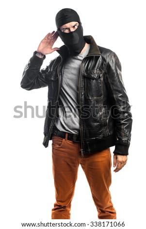 Robber listening something - stock photo