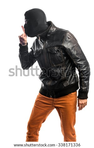 Robber making silence gesture - stock photo