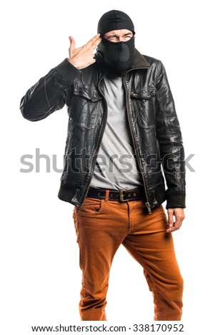 Robber making suicide gesture - stock photo