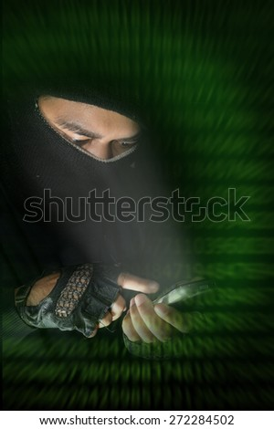 Robber man hacking by smart-phone. - stock photo