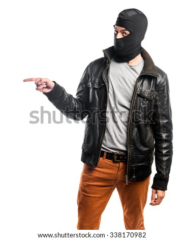Robber pointing to the lateral - stock photo