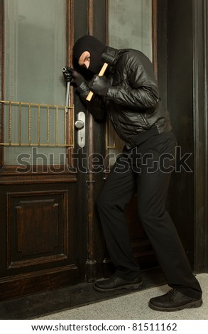 robber tries to break in - stock photo