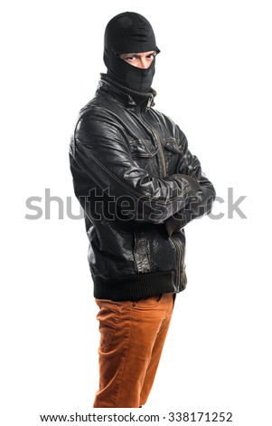 Robber with his arms crossed - stock photo