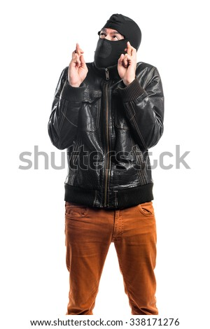 Robber with his fingers crossing - stock photo