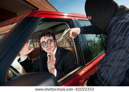 Robbery of the businessman in its car - stock photo