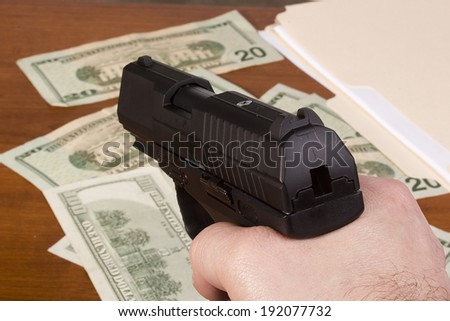 Robbery with the use of a gun. - stock photo