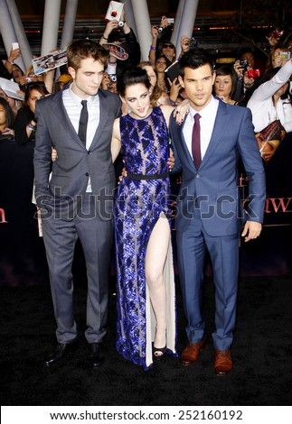 "Robert Pattinson, Kristen Stewart and Taylor Lautner at the World Premiere of ""The Twilight Saga: Breaking Dawn Part 1"" held at Nokia Theatre L.A. Live in Los Angeles on November 14, 2011.  - stock photo"