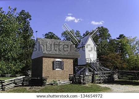 Robertson's Windmill and rustic fencing in Colonial Williamsburg, Virginia. The windmill was constructed for the purpose of grinding small grains. - stock photo