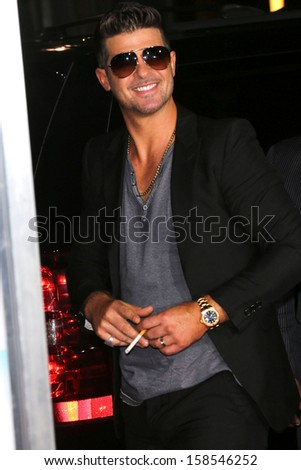 "Robin Thicke at the ""Baggage Claim"" Premiere, Regal Cinemas, Los Angeles, CA 09-25-13 - stock photo"