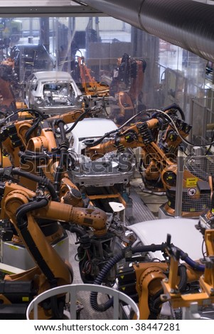Robot action in a car factory - stock photo