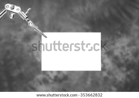 Robot arm holding blank business card  - stock photo