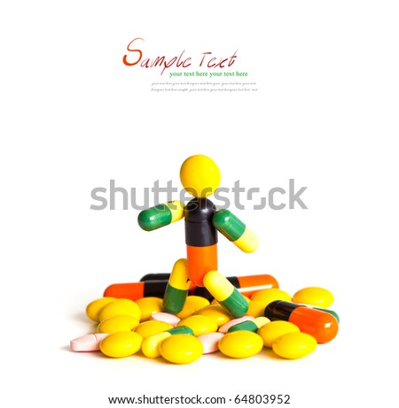 Robot (made of capsules and tablets) stand on white background with copy-space. - stock photo