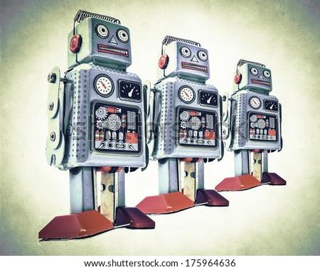 robot team in retro color - stock photo