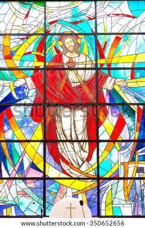 Rocca di Papa, Italy - circa June 2015 - Modern colorful stained glass window with Jesus Christ and Sacred Heart, Divine Mercy in a parish church - stock photo