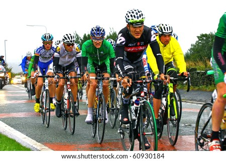 ROCHDALE, ENGLAND - SEPTEMBER 11: The Tour of Britain Professional Cycle race in rain soaked conditions on September 11, 2010 in Rochdale, England