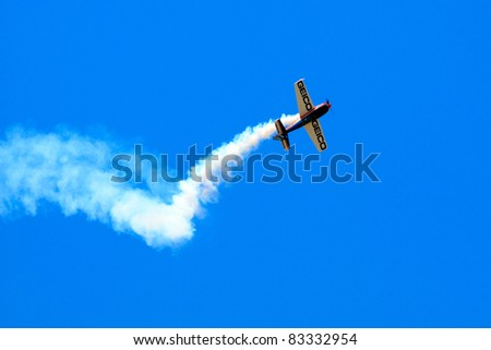 ROCHESTER, NY - JULY 17:  Stunt plane performing a corkscrew maneuver at an airshow in Rochester, New York on July 17, 2011