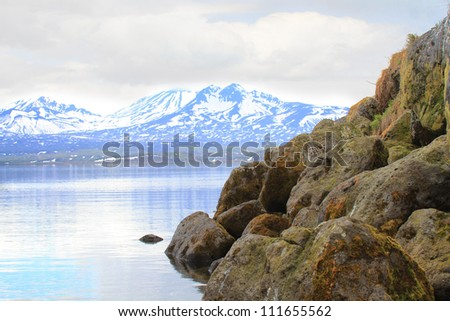 Rock  	against lakes and volcanoes of Kamchatka