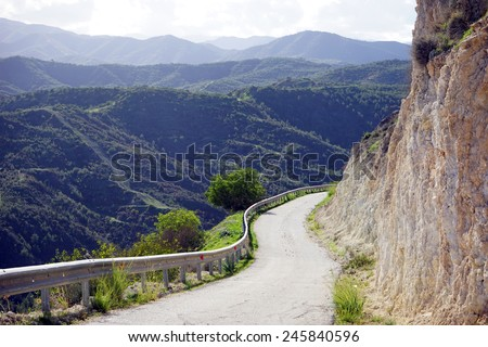 Rock and road in mountain of North Cyprus                                 - stock photo