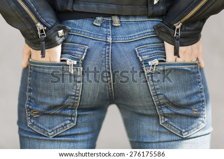 rock and roll butt  with blue jean - stock photo