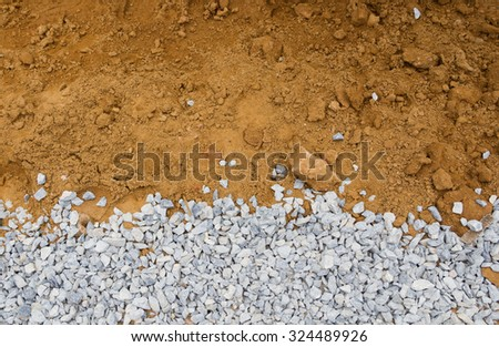 Rock and soil material on the road in the rural areas. - stock photo