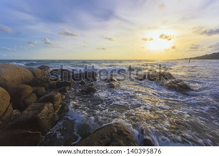 Rock and the sea at sunset