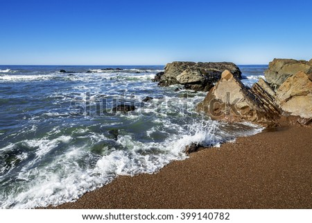 Rock and unusual geological formations at low tide, along the rugged Big Sur coastline, near Monterey, CA. on the California Central Coast, - stock photo