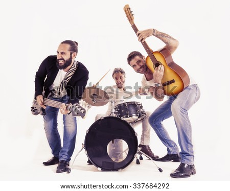 rock band performing in a studio - stock photo