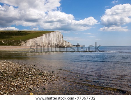 Rock beach and White Cliff at Seven Sisters Coast on a sunny day. - stock photo