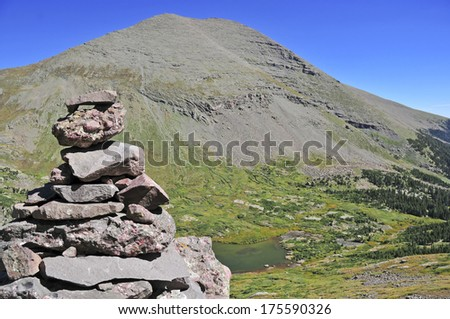 Rock Cairn and Humboldt Peak at South Colony Lakes, Rocky Mountains, Colorado - stock photo