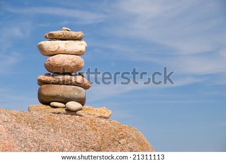 Rock cairn trail marker - stock photo