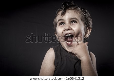 Rock, child rocker dress and funny expressions crested - stock photo