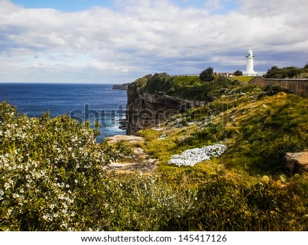 Rock cliff and lighthouse beside the sea at Sydney Australia - stock photo