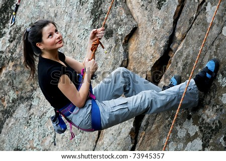 Rock climber hanging on the rope