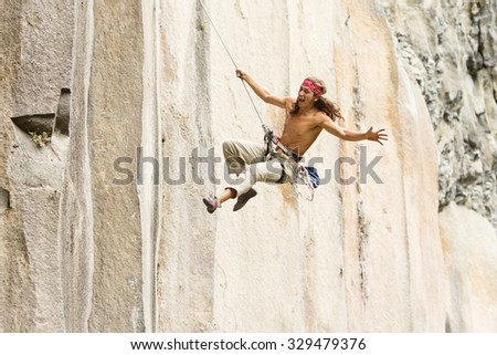 Rock Climber Jump May Very Well Suggest A Lover Running To His Girlfriend In Classical Rome And Juliet Posture - stock photo