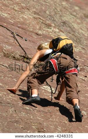 Rock Climber Leans Forward for the Next Hold on the Colorado Flatirons
