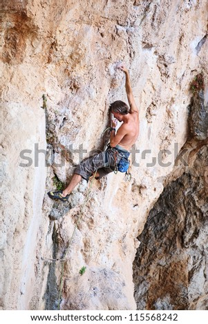 Rock climber on a cliff - stock photo
