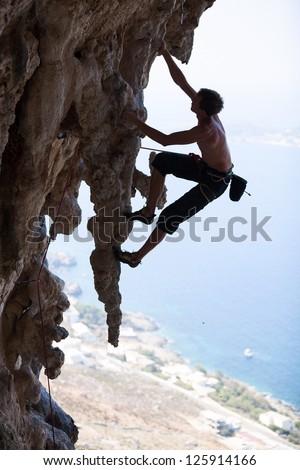 Rock climber on a cliff, Kalymnos Island, Greece - stock photo