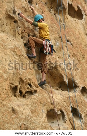 Rock climber on potholes route,		Smith Rock State Park, 	Central Oregon - stock photo