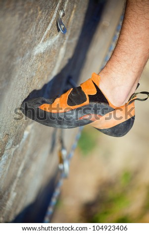 Rock climber's foot on track - stock photo