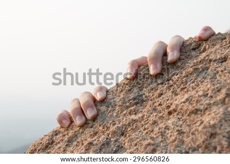 Rock climbing, close-up finger